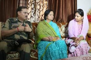 (From Left) BSF DG KK Sharma, along with BWWA president Renu Sharma , consoles the aggrieved family members of martyr Jitendra Singh, at his residence in Jaipur on Thursday.