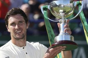 Mischa Zverev holds the winners trophy after beating Lukas Lacko in Eastbourne on Saturday.