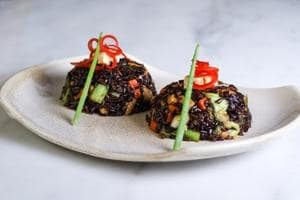 Organic aromatic Himalayan black rice tossed with vegetables and cottage cheese in Chinese style.
