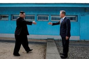 South Korean President Moon Jae-in and North Korean leader Kim Jong Un (L) are about to shake hands on their first ever meeting at the truce village of Panmunjom inside the demilitarized zone separating the two Koreas, South Korea, April 27, 2018.
