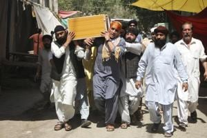 Sikhs carry a coffin of a relative killed in Jalalabad, Afghanistan, after Sunday's suicide bombing targeting the community.