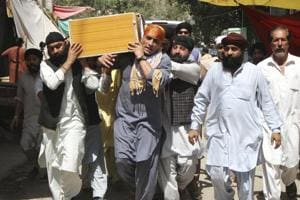 Sikh minorities carry a coffin of a relative killed in Jalalabad, Afghanistan, Monday, July 2, 2018. The Islamic State group has claimed responsibility for a suicide bombing in eastern Afghanistan that killed over a dozen people, mostly Sikhs and Hindus. (AP Photo)
