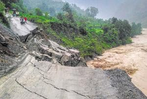A road leading to Rasiyabad village washed away after heavy rainfall at Munsiyari in Pithoragarh district on Monday.