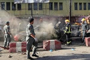 Afghan policemen inspect the site of a blast in Jalalabad city, Afghanistan, on July 1.