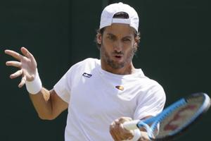 Feliciano Lopez of Spain returns the ball to Federico Delbonis of Argentina during their men