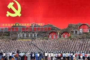 """Participants dressed in replica red army uniforms perform the """"Yellow River Cantata"""" to celebrate the upcoming founding anniversary of Chinese Communist Party, in Yanan, Shaanxi province, China."""