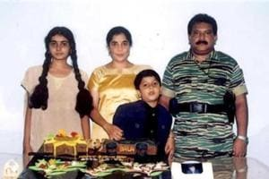 The late LTTE chief Vellupillai Prabhakaran (R) standing with his wife Mathivathani (2nd L), son Balachandran and daughter Duwaraka (L) in this handout photo.