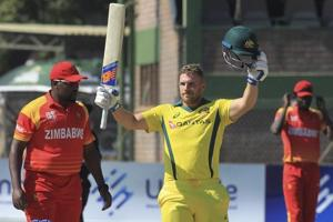 Australian batsman Aaron Finch celebrates scoring 100 during the T20 cricket match against Zimbabwe at Harare Sports Club, in Harare, Zimbabwe, Tuesday, July, 3, 2018.