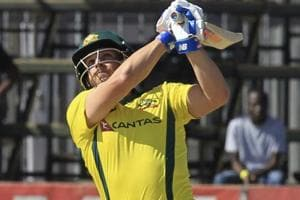 Aaron Finch celebrates sfter coring a century during Australia's T20 match against Zimbabwe at Harare Sports Club on Tuesday.