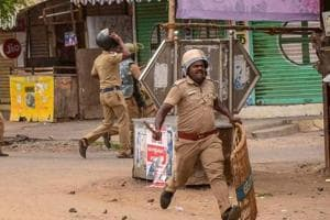 Police personnel resorts to lathi charge during the violent protest demanding the closure of Vedanta