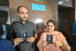 Mohammad Anas Siddiqui and Tanvi Seth show their passports issued to them by the Regional Passport Office, in Lucknow.