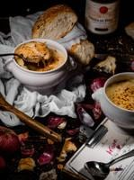 French Onion Soup  at  Artisan, Sofitel Mumbai BKC  is a slow cooked broth served in a crock  with bubbling cheese on toasted French bread, which hangs over the edges and sticks to the outer side of the crock