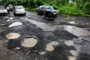 Potholes at Saket road ,India, on Wednesday, July 04, 2018