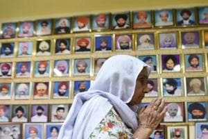 A woman pays tribute to victims of 1984 anti-Sikh riots. If we wish to expose something dreadful done by party A, we feel a need to balance it by finding a fault in party B.