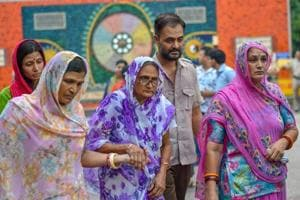 Relatives mourn during the cremation of 11 members of a family, who were found hanging in their house in Burari.