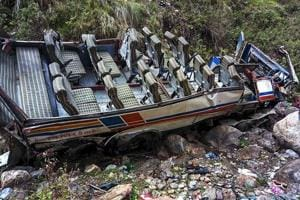The mangled remains of a bus that fell into a gorge. At least 48 people were killed and 12 others injured in the accident.