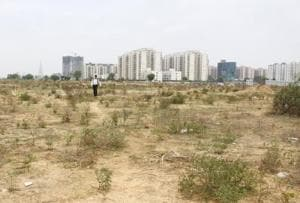 A vacant plot in  Gurugram's sector 70, where low ­rise apartments were to be constructed by realtors and delivered by 2014. Buyers have been protesting but are unsure of the delivery timeline.
