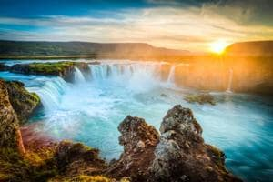 Direct flight to Iceland: The Goðafoss is a waterfall in Iceland. The country is filled with natural wonders.