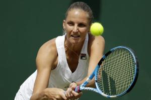 Karolina Pliskova of the Czech Republic returns the ball to Kiki Bertens of the Netherlands during their Wimbledon encounter.
