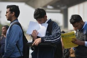 People apply for jobs at a job fair in New Delhi. The special edition of journal Yojana will carry details of jobs or avenues of self-employment.