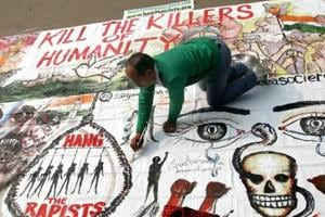 A  man  makes paintings during a protest at Delhi's Jantar Mantar against the  December 16, 2012, gangrape incident.