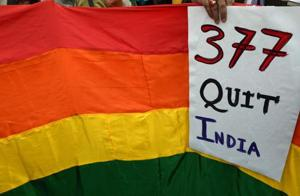 A gay rights activist holds up a placard against Section 377 as they take part in a protest against the Supreme Court ruling reinstating a ban on gay sex, in Kolkata on December 15, 2013.