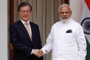 South Korean President Moon Jae-in shakes hands with Prime Minister Narendra Modi ahead of their meeting at Hyderabad House in New Delhi, on Tuesday.