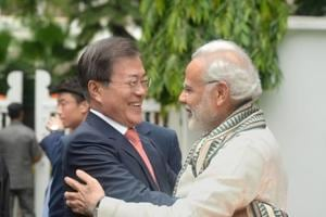 South Korean President Moon Jae-in is hugged by Prime Minister Narendra Modi during their visit to Gandhi Smriti in Delhi on July 9, 2018.