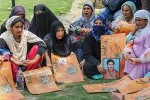 Relatives of missing persons display placards during a silent sit-in protest  in Srinagar on July 10, 2018.