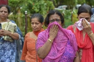 Relatives mourn during the cremation of the 11 members of a family who were found hanging in their house in north Delhi's Burari on July 1, 2018.