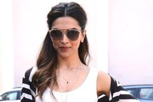Deepika Padukone's airport style is proof that there's nothing chicer — or easier — than styling an outfit that's black and white.  (Instagram)