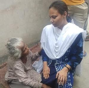 District legal service authority secretary Gurpreet Kaur (in blue) with 101-year-old Krishna Dasi.