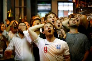 England fans react during their team's FIFAWorld Cup 2018 semi-final match against Croatia on Wednesday.