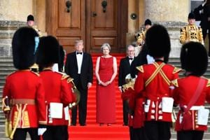 US president Donald Trump, from left, Theresa May, UK prime minister, and her husband Philip May watch a live military performance by the bands of the Scots, Irish and Welsh Guards ahead of a dinner at Blenheim Palace in UK on Thursday.