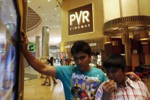 Cinema-goers watch a movie trailer at a PVR Multiplex in Mumbai