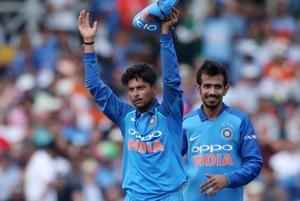 Kuldeep Yadav (L) celebrates taking the wicket of England