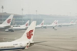 Air China planes parked at the Beijing Capital International Airport on April 6, 2017.