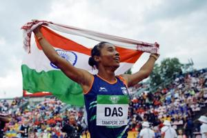 Hima Das of India, celebrates her victory in women