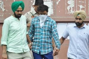 The accused being produced at the Mohali district court.