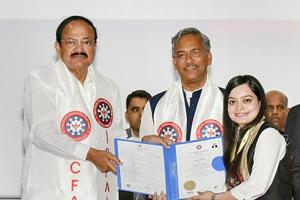 Vice-president M Venkaiah Naidu presents a certificate to a student during the convocation of ICFAI University in Dehradun on Saturday. Uttarakhand chief minister Trivendra Singh Rawat is present.