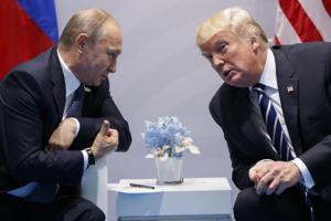 US president Donald Trump with Russian president Vladimir Putin at the G-20 Summit on July 7, 2017, in Hamburg. The summit between Trump and Putin will go ahead as planned on Monday, the White House has said.