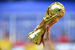 A replica of the FIFA World Cup trophy is brandished by a football fan before a Russia 2018 World Cup football match in Moscow.