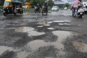 Potholes at Teen Hath Naka in Thane creating problems for the people.