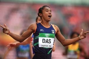 Indian athlete Hima Das celebrates after winning gold in the final of the women