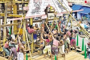 Bhois, the group of workers who do all the heavy lifting, fix the dwarbedha – an arched section on four sides of the chariot - on to Jagannath's rath.