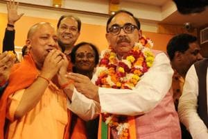 Uttar Pradesh BJP state president Mahendra Nath Pandey offering sweets to Chief Minister Yogi Adityanath after winning in UP Civic Polls in Lucknow.