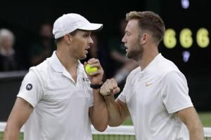 Mike Bryan and Jack Sock of the United States celebrate after winning a point in their men