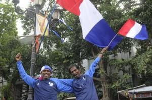 Manik Khatik (R) and Babuli Nayek, two die hard fans in Chandannagar, former French colony, dressed in the team's jersey before the FIFA World Cup 2018 final.