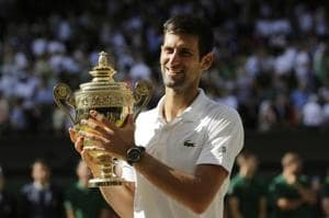 Novak Djokovic of Serbia holds the trophy after defeating Kevin Anderson of South Africa in the men
