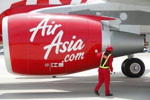 An AirAsia Japan Co  engineer looks at an engine of the company
